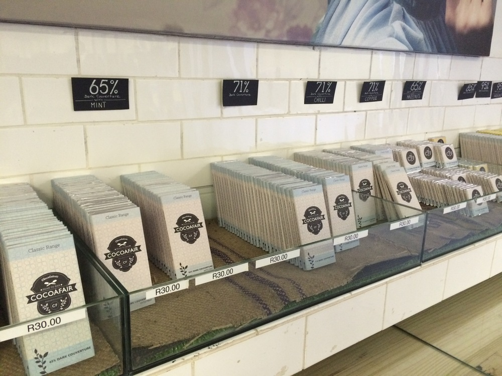 "Gourmet, YUMMY, hand made chocolates by CocoaFair, ""Africa's first bean-to-bar chocolate factory founded on the principles of social entrepreneurship."""