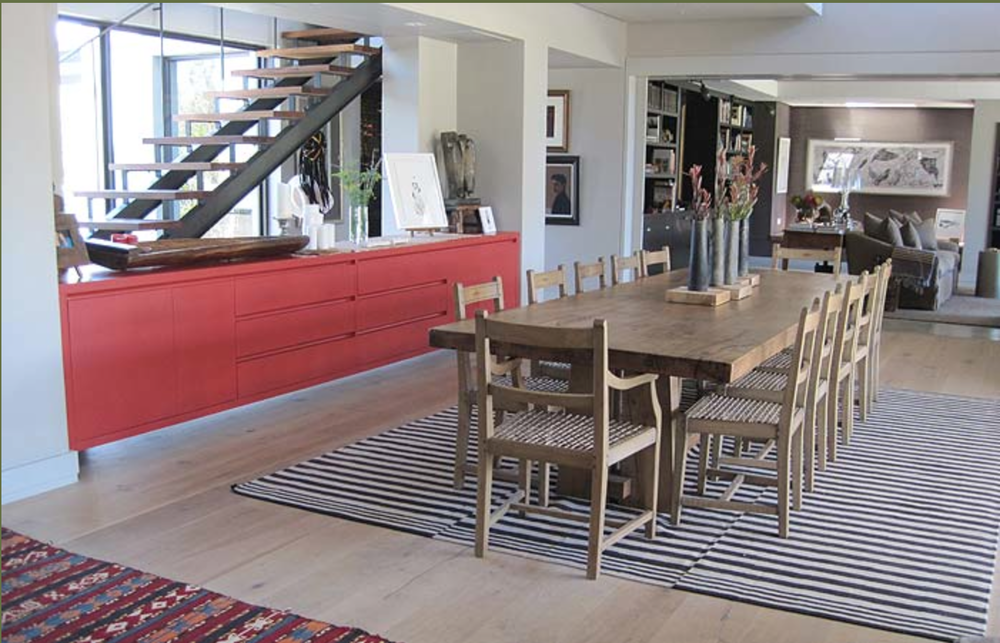 That red sideboard is a wonderful touch.