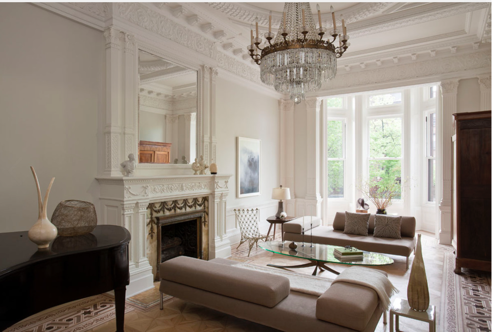 Rather traditional architecture painted in stark white becomes the perfect backdrop for the more contemporary furniture in the space.  {Via Houzz}