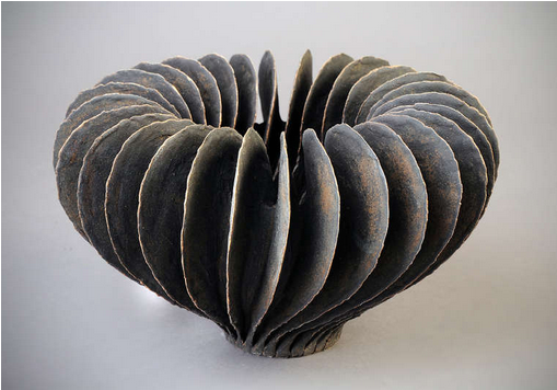 Sliced apple?  Or simply a stunning piece of art.  VIA: 1st Bid