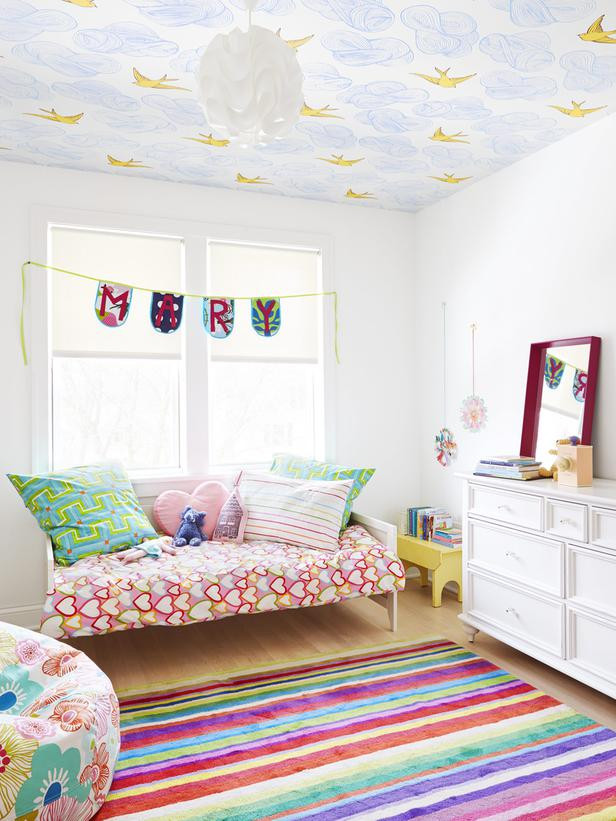 Hygge and West's wallpaper -  Daydream  - is the perfect ceiling treatment in this little girl's room.