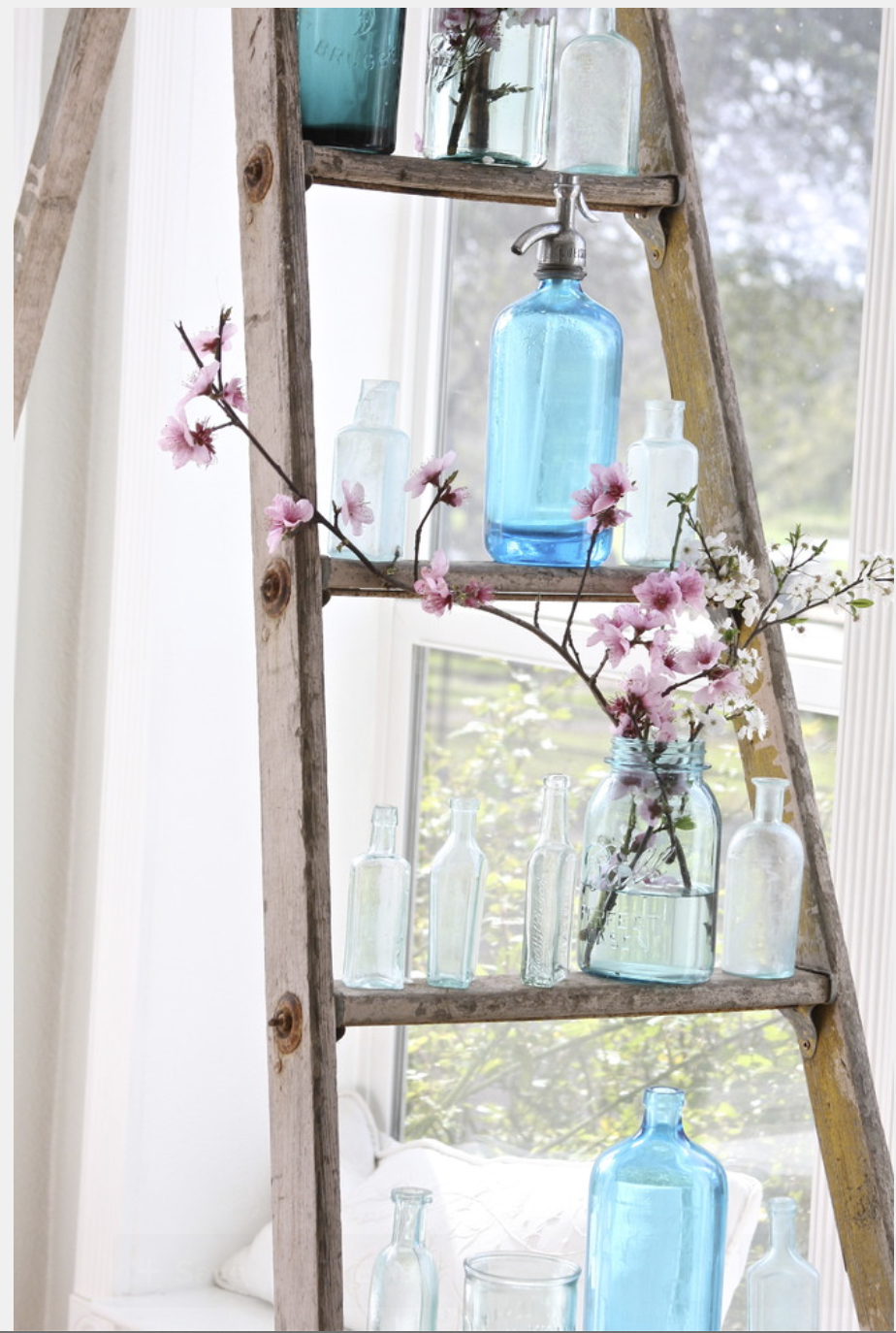 These apothecary bottles are perfect on their own or to house some simple buds for an additional splash of color.  {Via  Houzz }