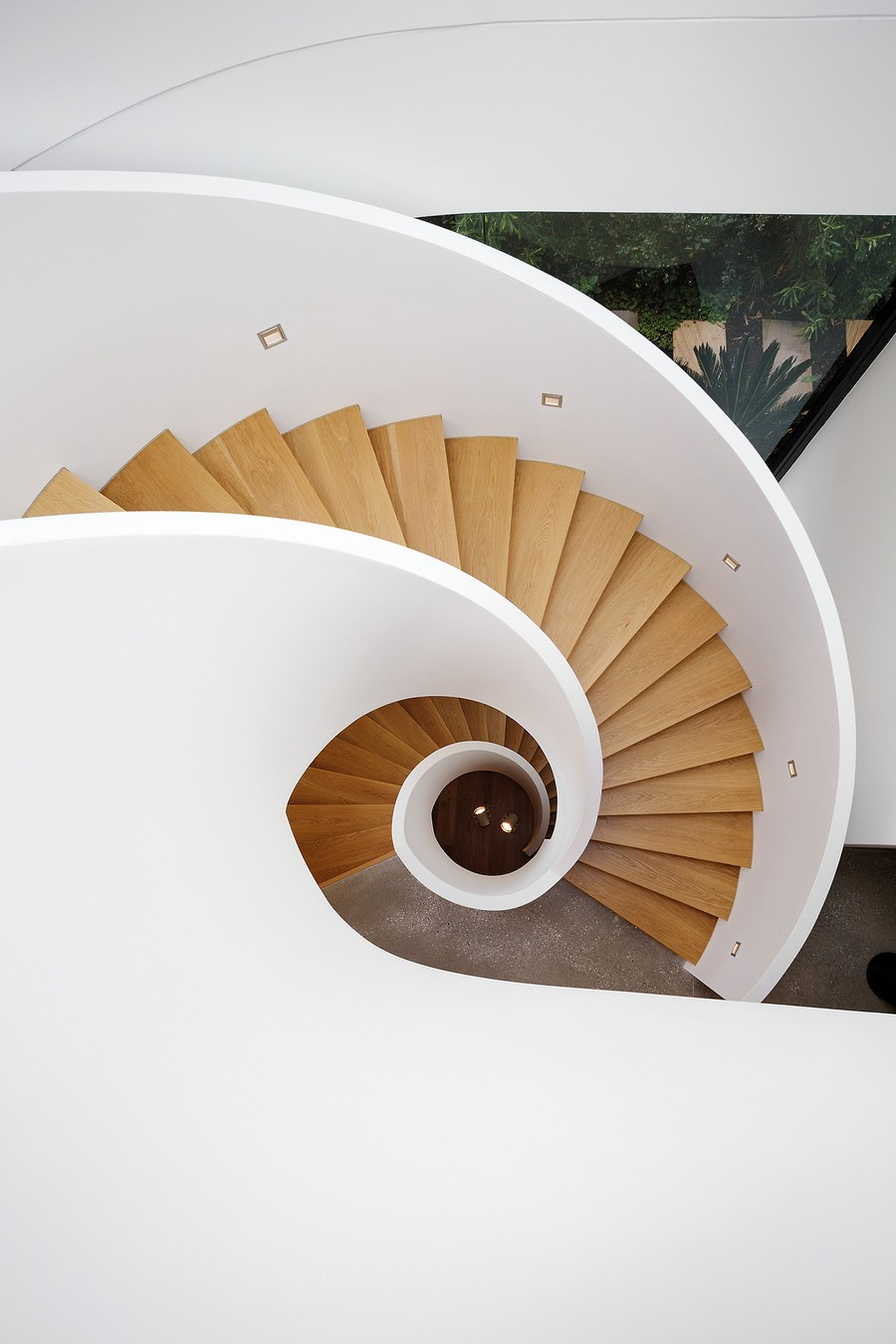 A more modern and gorgeous, nautilus-inspired staircase {Via  Freshome }