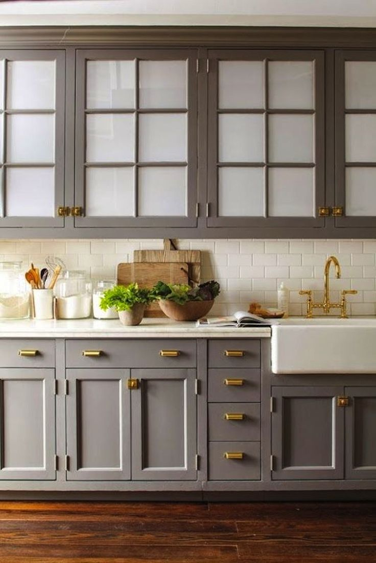 These cabinets look gorgeous.  From what I understand, frosted windows are etched with acid to properly cloud the surface.  But for a faster, more economical change, it's worth checking out  Decorative Films  for films that can mimic the look without the cost.  {Photo Via Pinterest} or even  Rustoleums Frosted Glass Spray .  Check out this  blog post  for some guidance.
