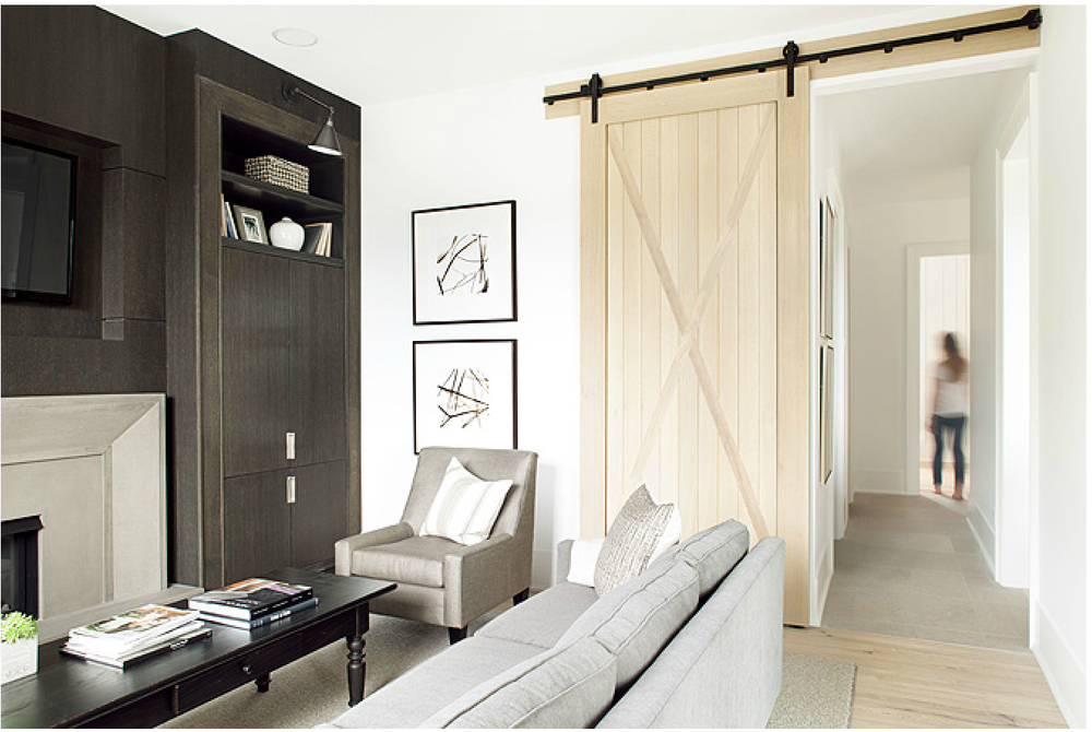 This natural wood door is very zen, isn't it? {Via  Kelly Deck Interiors }