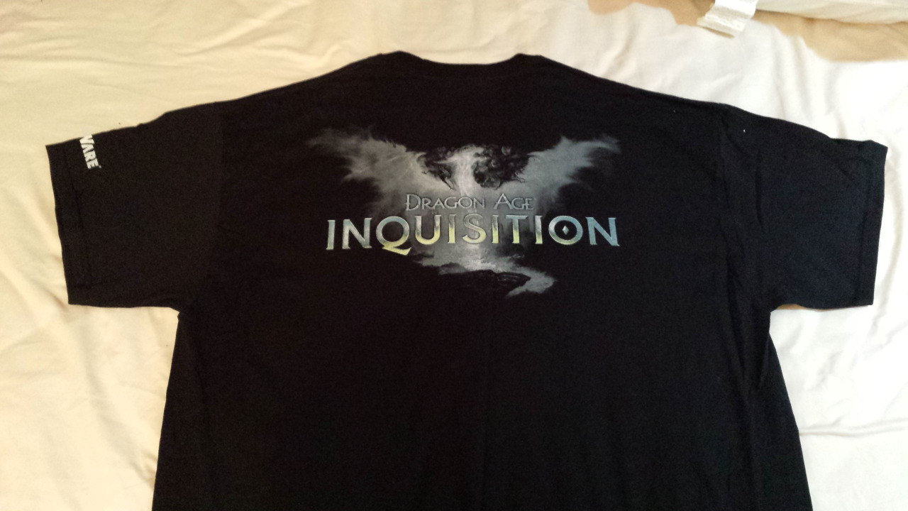 Today's the last day to enter to win this shirt!  Quick Facts on the Shirt: Two Shirts up for grabs: one Men's Large, one Men's XL Same shirt given at E3 of this year Front side: Inquisitor extending his arm into the sky (from the box art) Back side: Pictured above. Bioware logo is on the left International entrants welcome! One entry per person. Only one will be considered! Winners will be announced on Wednesday, July 2 How to Win Get on Twitter! Tweet details on your Inquisitor with the hashtag #DAIGW (Inquisitor's name, race, class, a hero of Order or Change, etc) Tweet your entry before 11:59PM Pacific Time (California) on June 30th And that's it! Good luck.