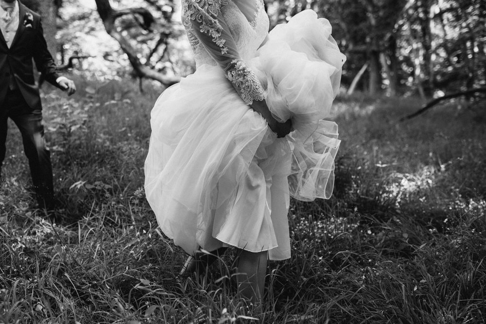 Adventurous bride hiking the forest