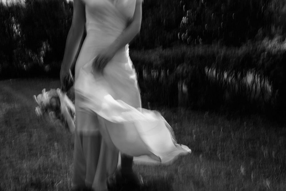 Bride twirling in her silk Cortana dress