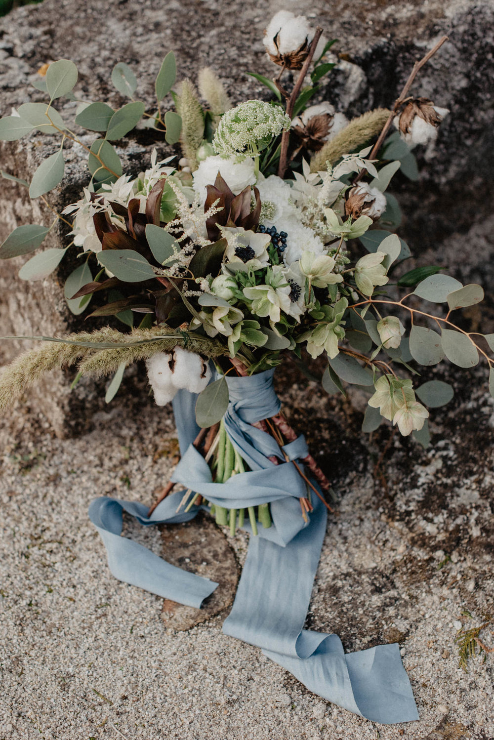 wedding-bouquet-with-blue-ribbon-and-cotton-flowers.jpg