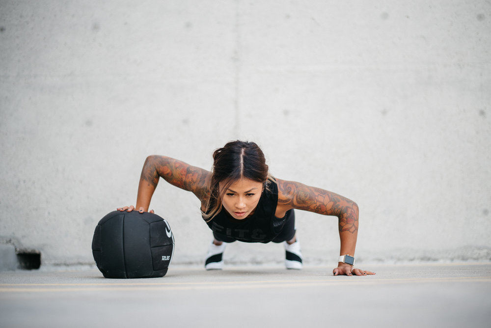 Alternating Push ups on medicine ball