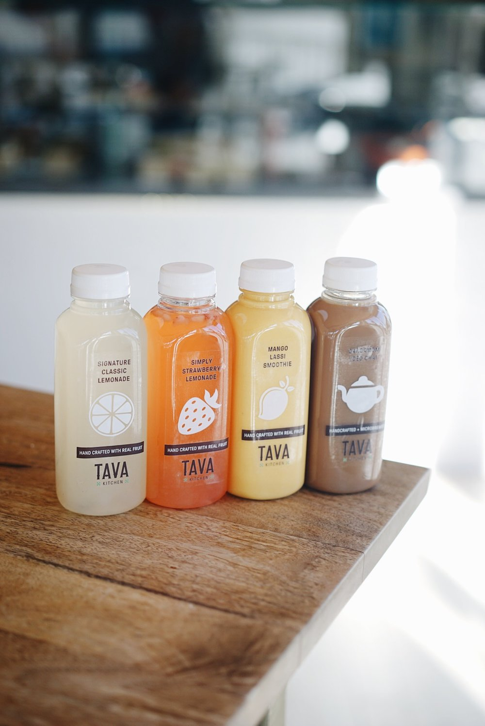 Fresh juices and syrups made in house by Tava Kitchen.