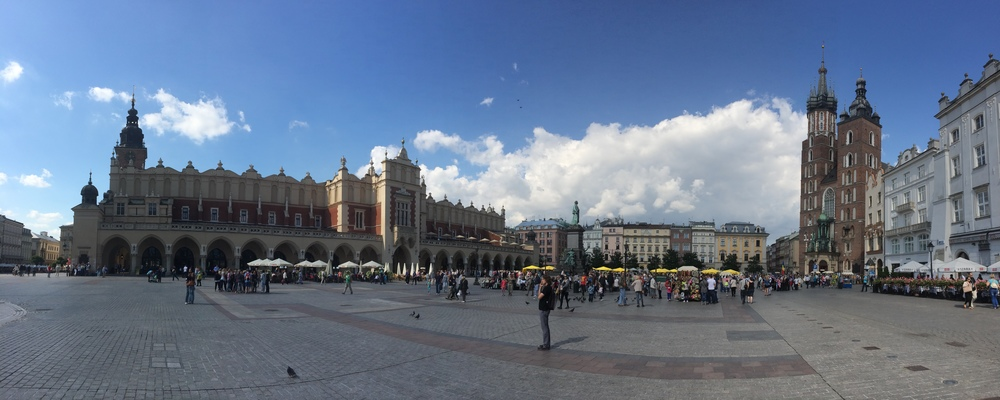 View of the main square in Krakow with the old Cloth Market to the left and St. Mary's Basilica to the right.