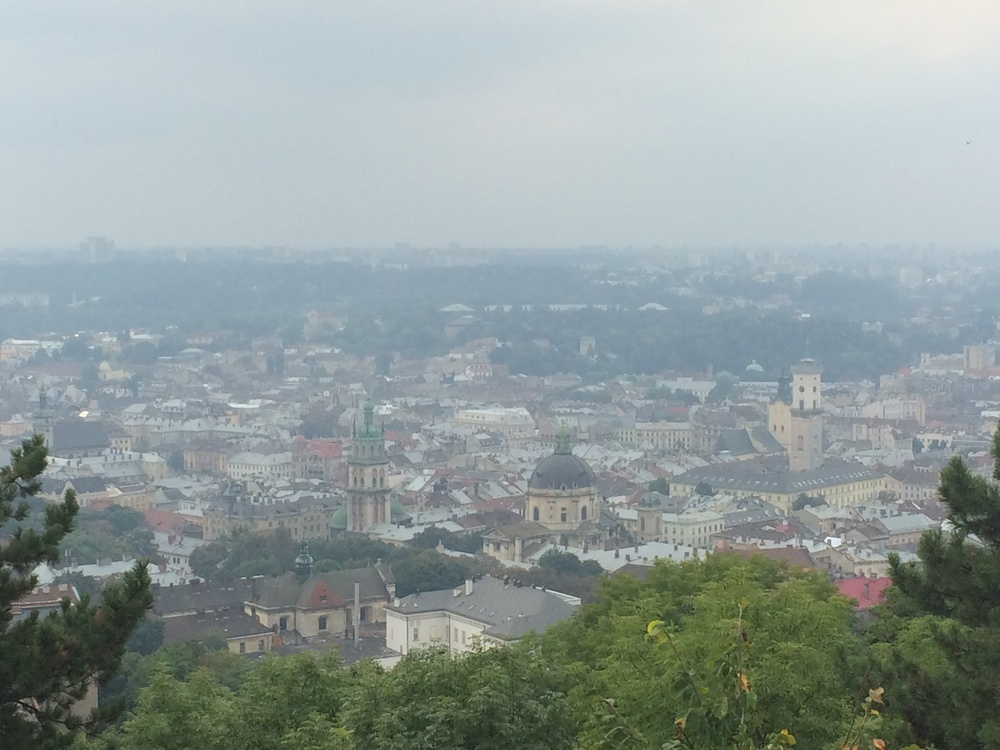 View of old town Lviv from the High Castle Hill with the Town Hall building in Rynok Square.