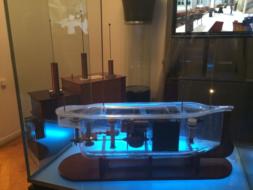 Model of Tesla's first remote controlled boat with the controller in the background.
