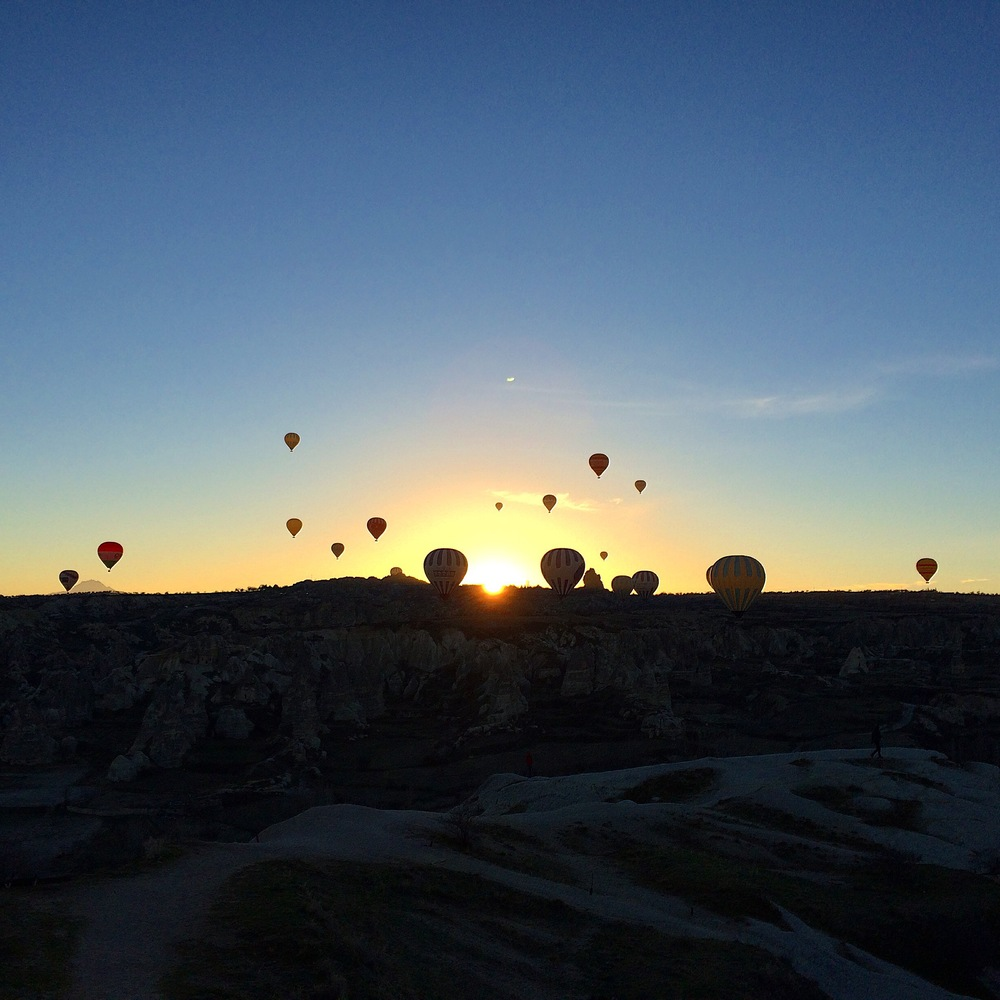 Hot air balloons at sunrise in Cappadocia.