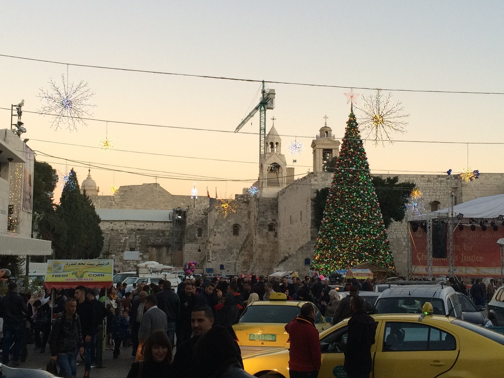 Manger Square with the Church of the Nativity in the background (under the crane).