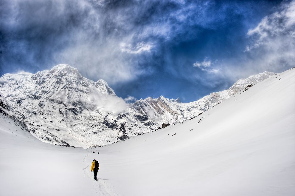 A mountaineer hikes the Annapurna region on the Nepal side of the Himalaya.  PHOTOGRAPH BY SERGE MICHELS, NATIONAL GEOGRAPHIC