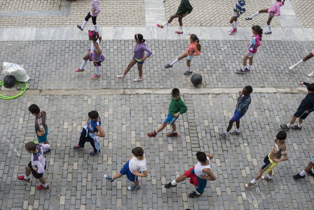 School children participate in exercises in the Plaza Vieja in Old Havana, Cuba on Jan. 18, 2016.