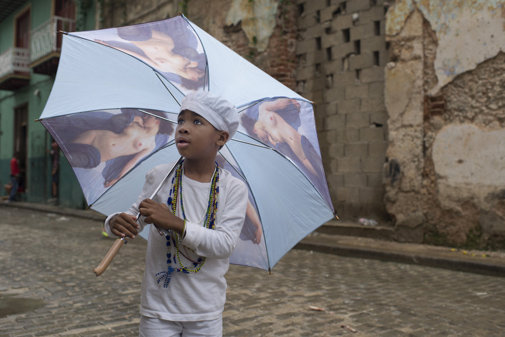 A young boy looks at American students in Old Havana, Cuba on Jan. 22, 2016.