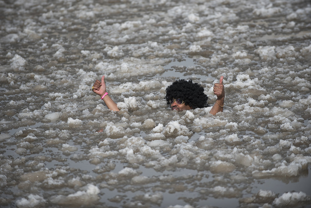 Walt Sanders gives a thumbs up at the annual Polar Plunge in Rochester, N.Y. on Feb. 14, 2016. Sanders has participated in the event for 14 years. The Polar Plunge supports the Special Olympics.