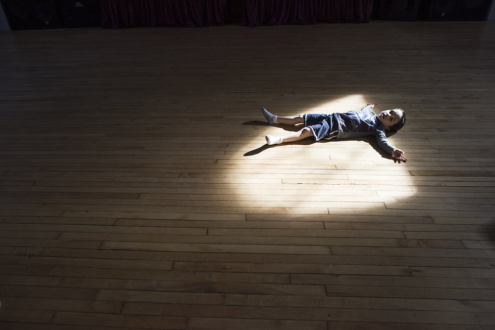 Elijah Orlowski, 5, lays in the sunlight at The Historic German House in Rochester, N.Y. on Feb. 20, 2016.