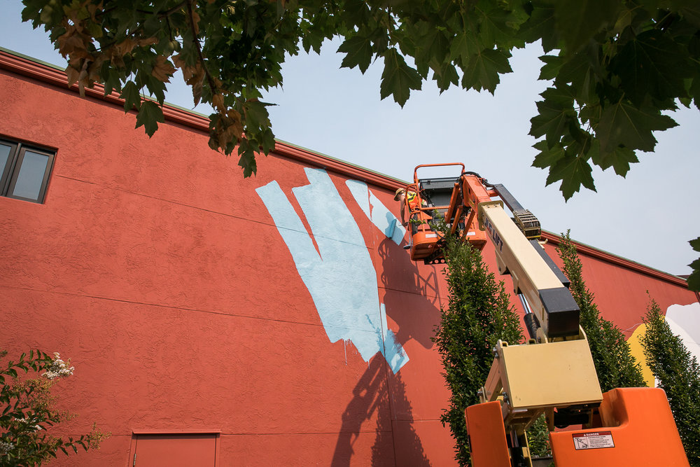 Heather Day works on her mural at Provenance Vineyards in Napa Valley