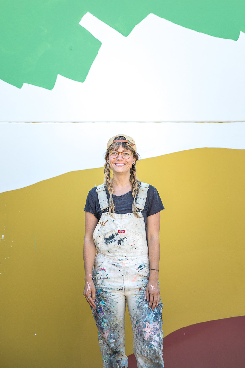 Heather Day's stands with her mural at Provenance Vineyards in Napa Valley