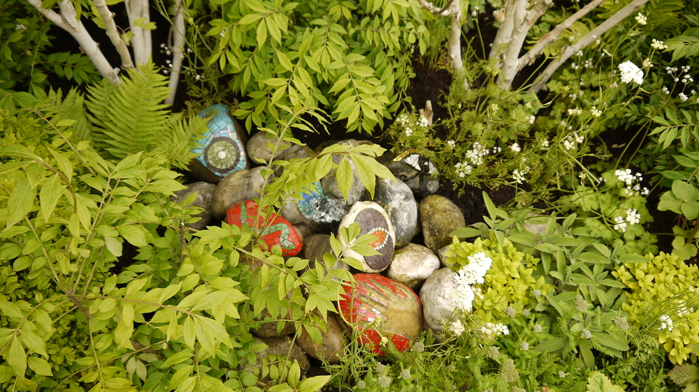 Water feature subtly placed under the birch trees with mosaic rocks by Dawn