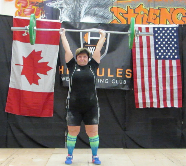43kg Clean & Jerk (all three attempts successful, this was the last weight). Click on the image to increase the size and check out the fingers of her right hand. KDog managed to finish the lift, even though her fingers weren't all around the bar. WOW!