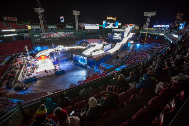 BOSTON, MA - February 8, 2019: Fans look on as competitors head down the course the during the Men's Qualifier in the Red Bull Crashed Ice ice cross downhill world championships at Fenway Park on Friday, February 8, 2019 in Boston, Massachusetts. (Staff photo By Nicolaus Czarnecki/MediaNews Group/Boston Herald)