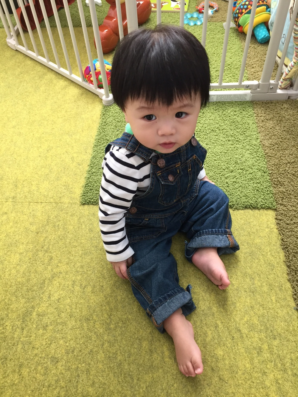 Phil wearing Gap long-sleeved onesie and OshKosh B'gosh overalls