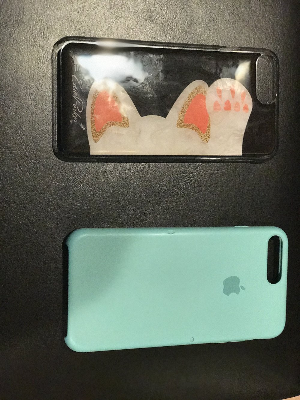 even though my silicone case from Apple is chipped, it still looks cleaner and newer than my just-opened Edie Parker goo.ey iPhone case