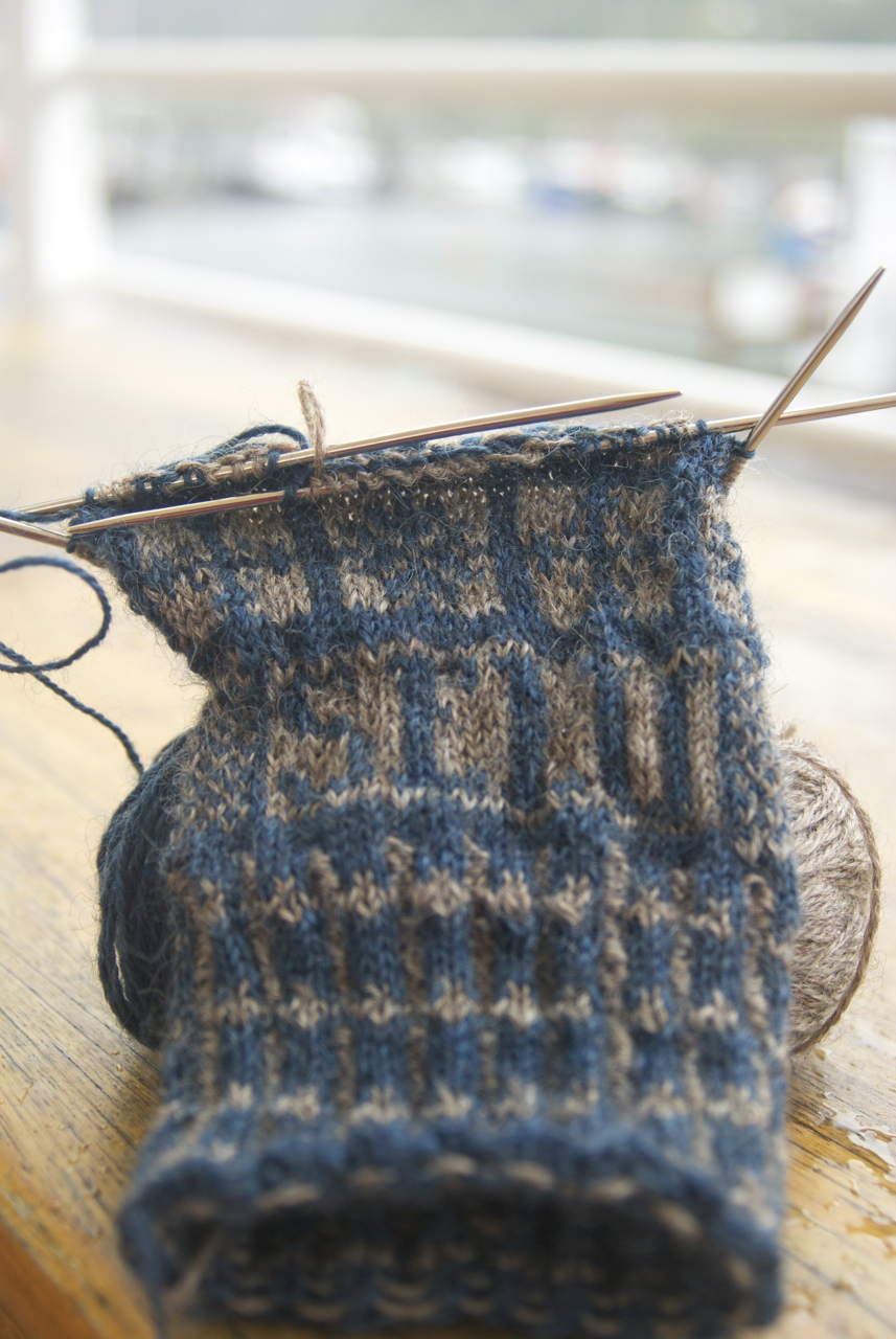 Beth Brown Reinsel's Compass Rose Sanquhar gloves in 3-Ply Cotswold x Romney Silver Base fingering weight in Granite and Dark Indigo