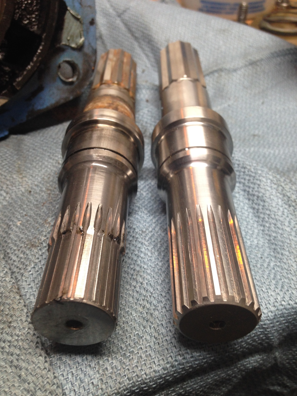 Raw water pump drive shafts, bad and new.  Note how worn the teeth are on the one on the left.  This is not good.
