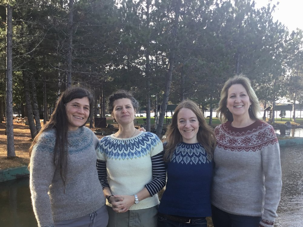 A couple couple of Jennifer Steingass (in her blue Arboreal) designs, caught for a group photo at the Highlands on the Fly knitting retreat in Millinocket, Maine in October.