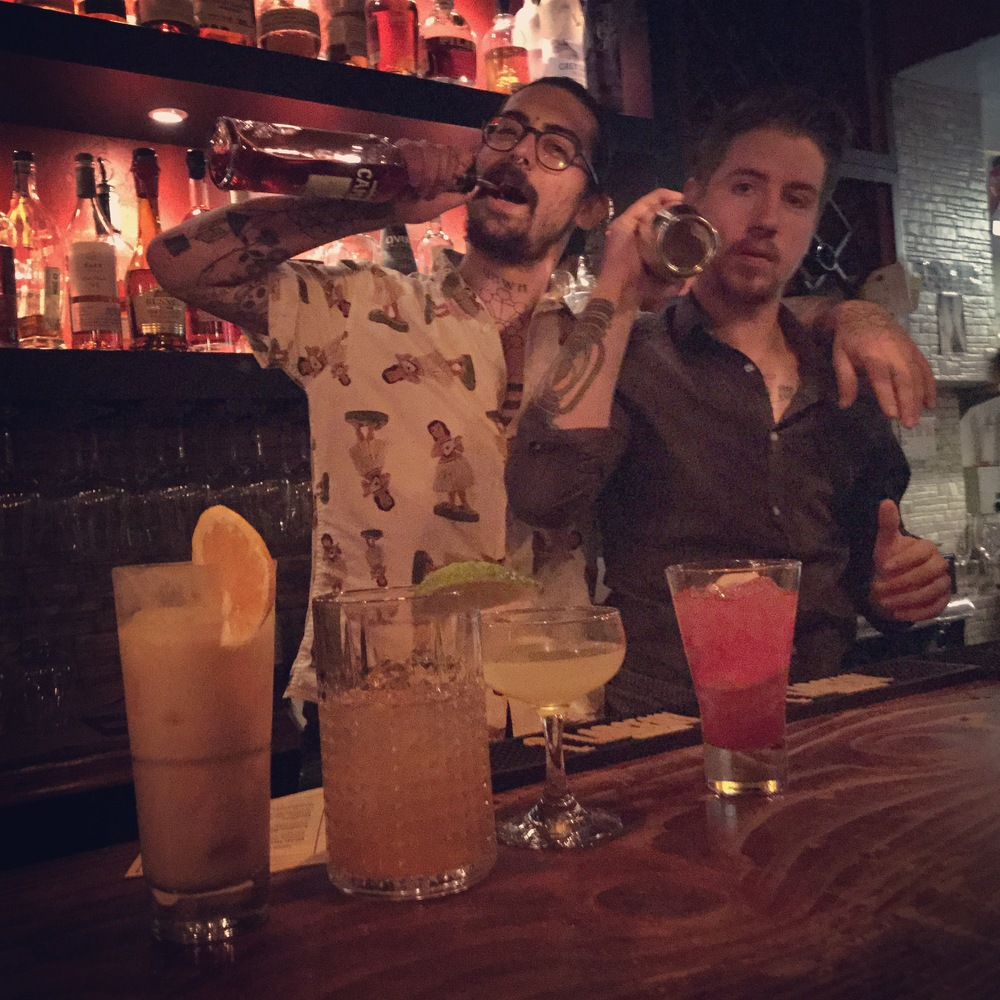 Dezman Turner (left) & Chase Henrixen (right) behind a lineup of Chase's signature concoctions