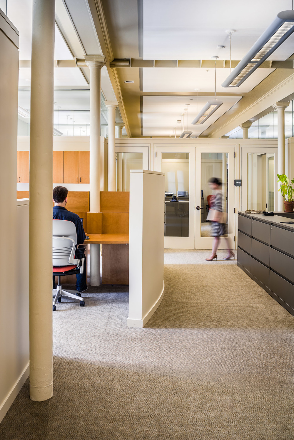 Adaptive Reuse Design, Administrative Office Photographed for Futures Without Violence The strong lines and receding perspective of this space drew me to this image. I love the subtle play of reflections in the glass above and in the door.