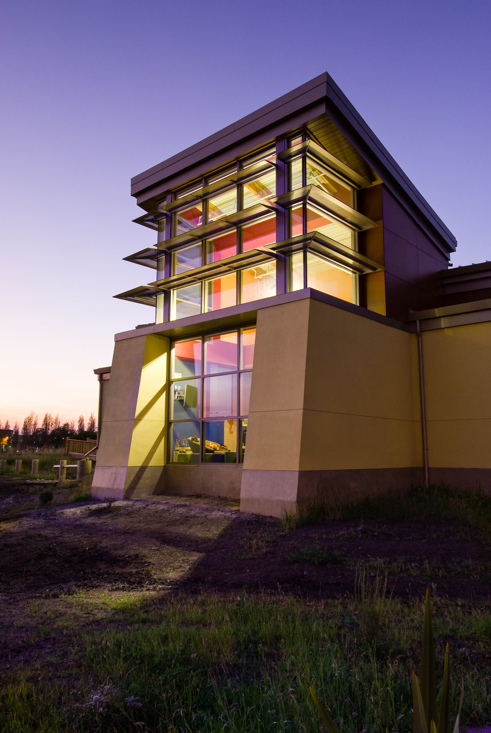 Redwood Shores Public Library, Children's Reading Room, Exterior, Dusk Photographed for Anderson Brule´ Architects, Kitchell CEM and OMM Consulting 2009 WCC Outstanding Achievment Award Communicating the design concept required photographing the tower at dusk. Shooting into the sunset was not a challenge because we had to shoot very late in the day to capture the light spilling out into the marsh.