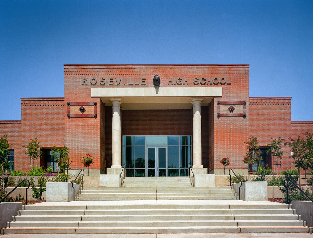 Roseville High School, Front Exterior, Entrance One Point Photographed for Williams + Paddon Architects + Planners 2002 AIA Merit Award My first impression was the of timelessness of the design. The entrance communicated the idea of time honored traditions with such quiet dignity and respect. The only way to capture that feeling was from a dead center one point perspective with perfectly symmetrical lighting.