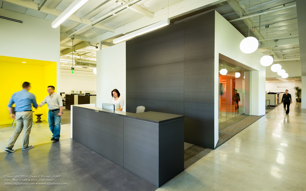 Formal conference with reception seating, reception desk and corridor recession, including people. Project Divcowest in Santa Clara, CA Photographed for Studio G Architects