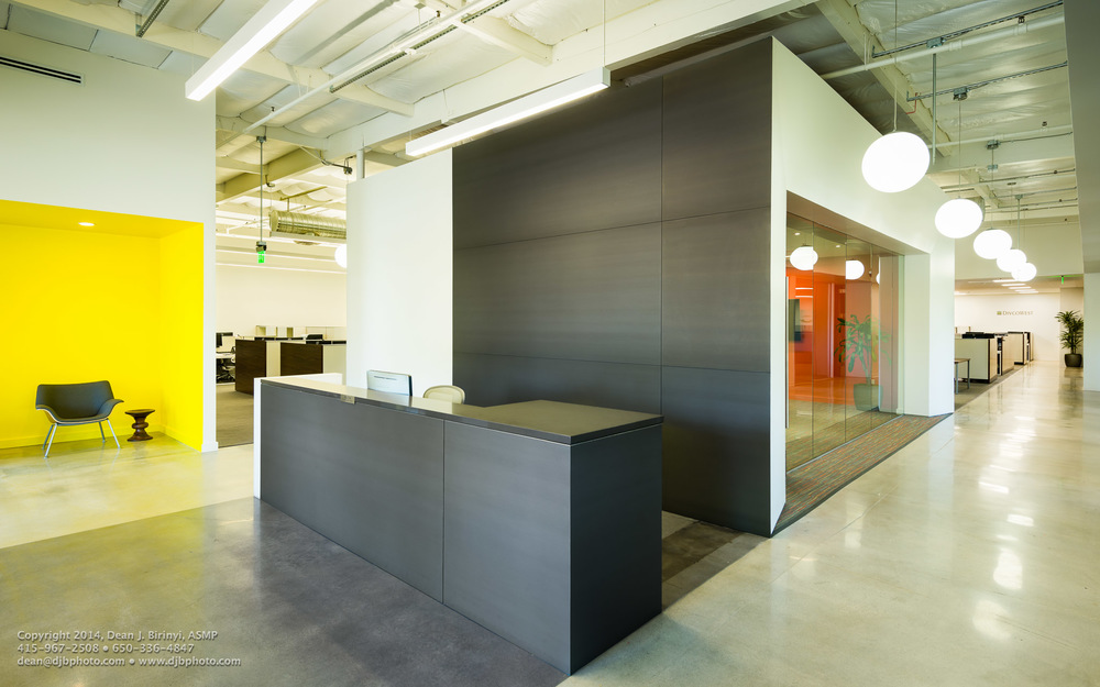 Formal conference with reception seating, reception desk and corridor recession. Project Divcowest in Santa Clara, CA Photographed for Studio G Architects