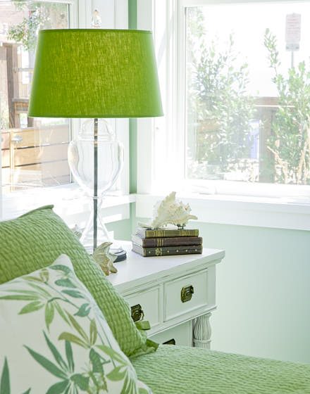 Vignette of nightstand and pillow covers in a bright and cheery guest bedroom in Santa Cruz, CA.  Photograph by Dean Birinyi, an interior photographer based in San Francisco, CA.