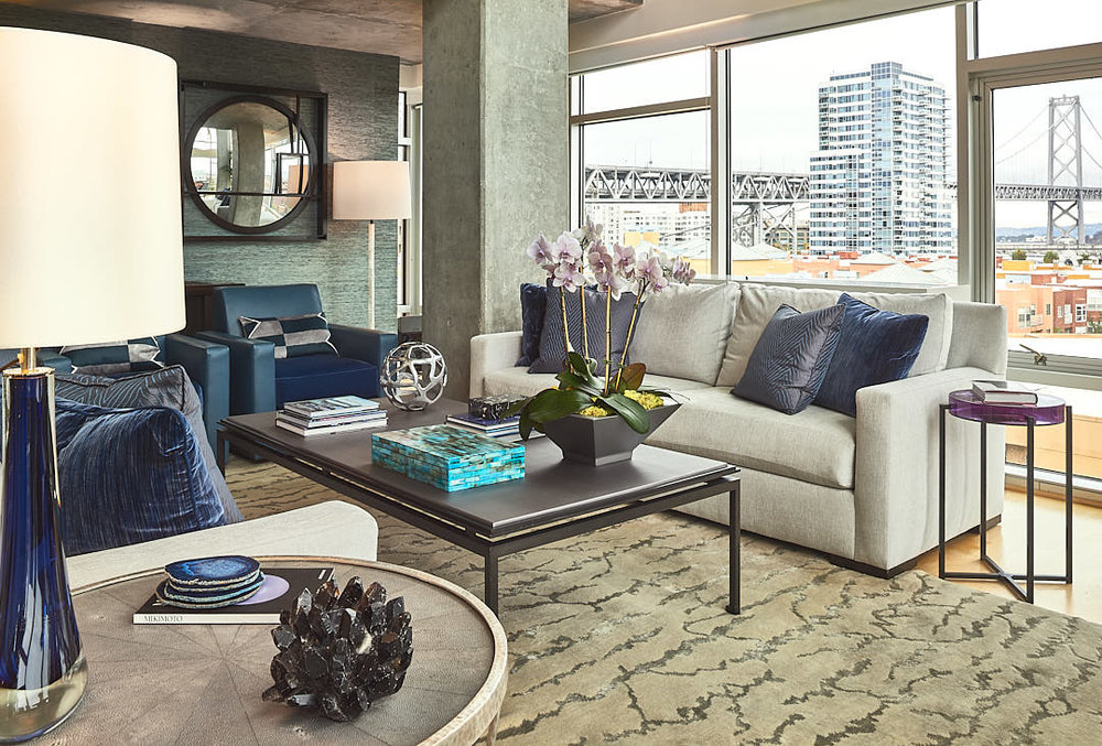 Contemporary living room in South Beach district of San Francisco, CA showing view of Bay Bridge used to illustrate the expected results of using supplemental light to photograph interiors.  Photographed by Dean Birinyi, interior photographer in San Francisco, CA.