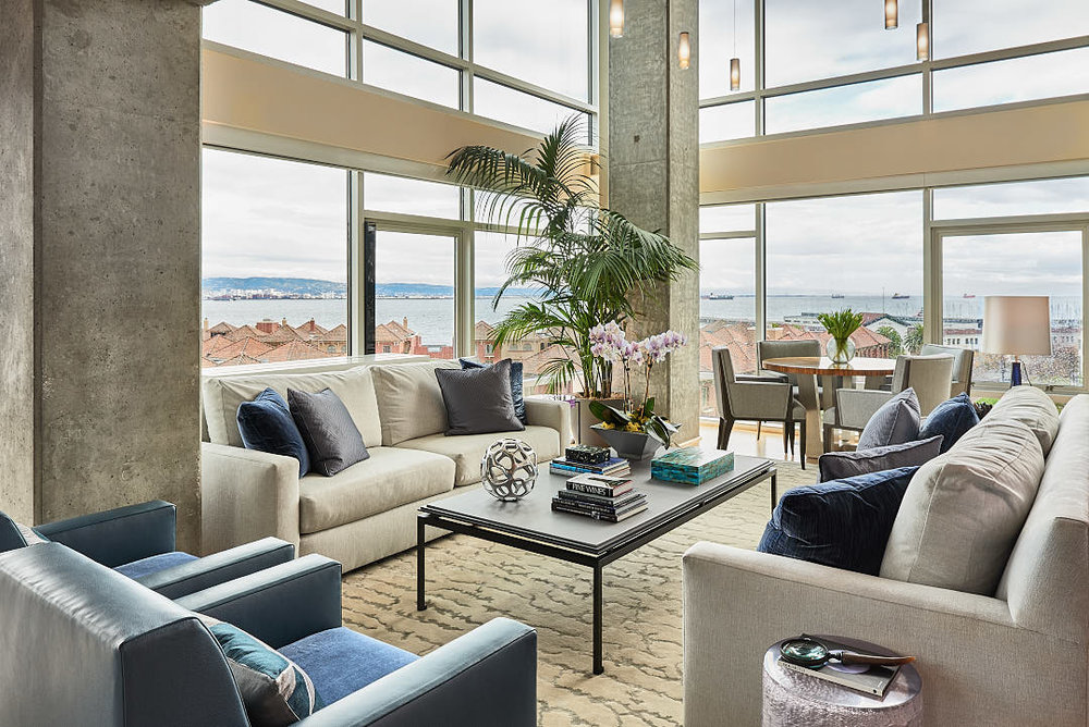 Photograph of a contemporary living room in South Beach district of San Francisco, CA showing bay view. Used to illustrate the quality of imagery attainable when using supplemental lighting to photograph interiors.  Photographed by Dean Birinyi, interior photographer in San Francisco, CA.