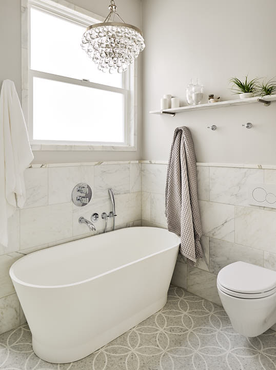 Elegant master bathroom in Presidio Heights neighborhood of San Francisco, CA showing tub, tile and chandelier.  Photographed by Dean Birinyi, interior photographer in San Francisco, CA.