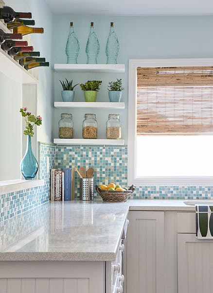 Available Light detail of a residential kitchen in Monterey, CA showing glass tile back splash, cabinets, counter shelving, and built-in wine rack.  Photograph by Dean Birinyi, an interior photographer based in San Francisco, CA.
