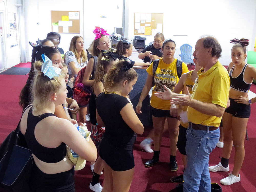Peter Volum welcomes a gymnastics group to the facility.