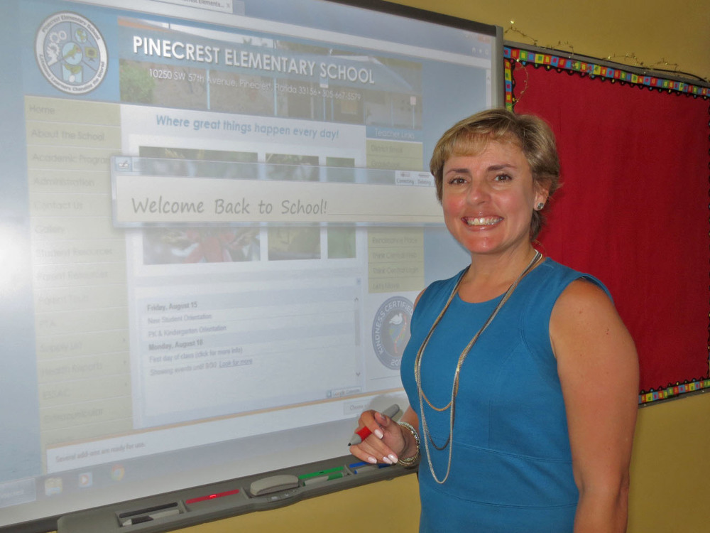 Pinecrest Elementary Principal Marisol Diaz at interactive smartboard