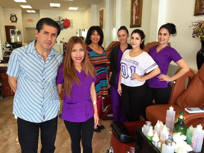 [L to R] Olive's Nail and Spa owners Tony Rad and his wife Jenalyn Avella, along with technicians Francesca Acosta, Lavane Brown, Monica Franco and Diane Silva