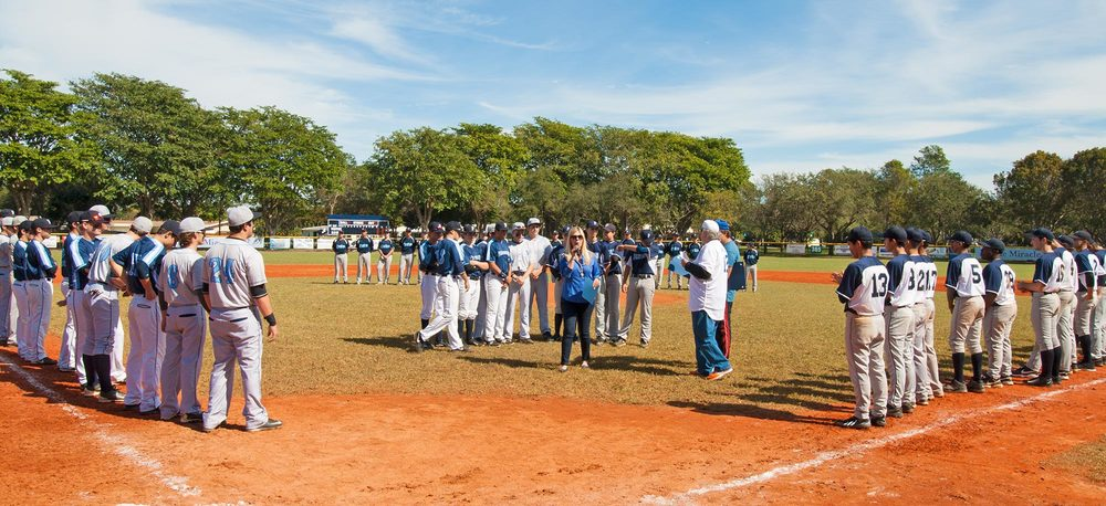 Palmetto Bay councilwoman Karyn Cunningham hands our awards to deserving players after the Miracle League baseball game.
